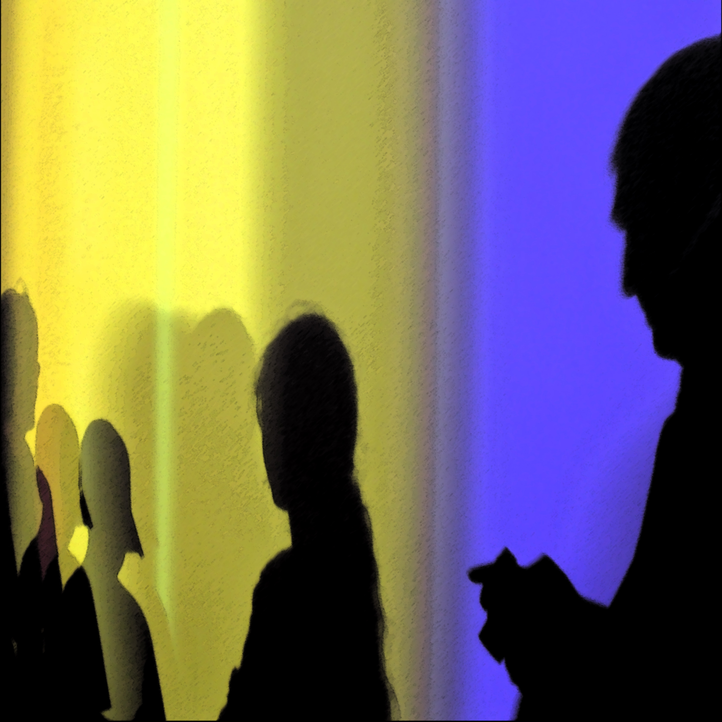 Shadow of family cast by vert. bands of blue and yellow light. Dad holds phone.