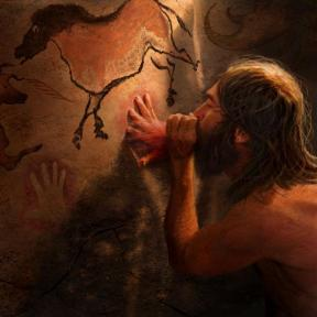 Early human creating cave art. Image courtesy of Karen Carr Studio.